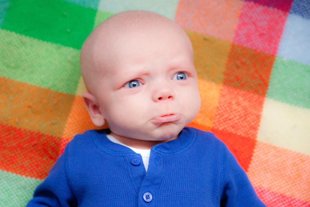 documentary family photography - sad baby